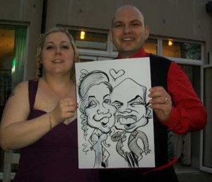 pointed shaped head makes guests laugh at the caricature at a wedding in tunbridge wells