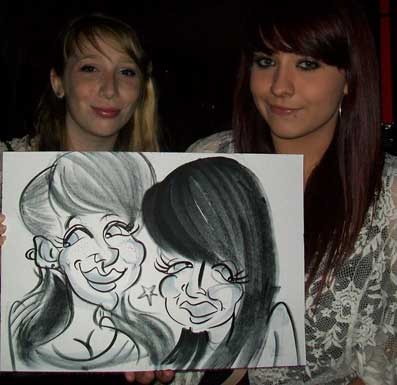 best friend pose with their caricatures at plumpton college