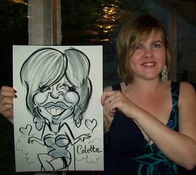 colette and her caricature at a college prom in chichester