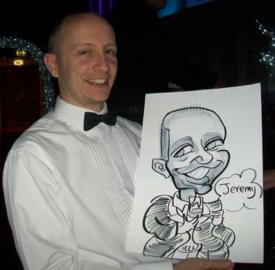 jeremy has had a lot to drink but happy to get a caricature at a works christmas party