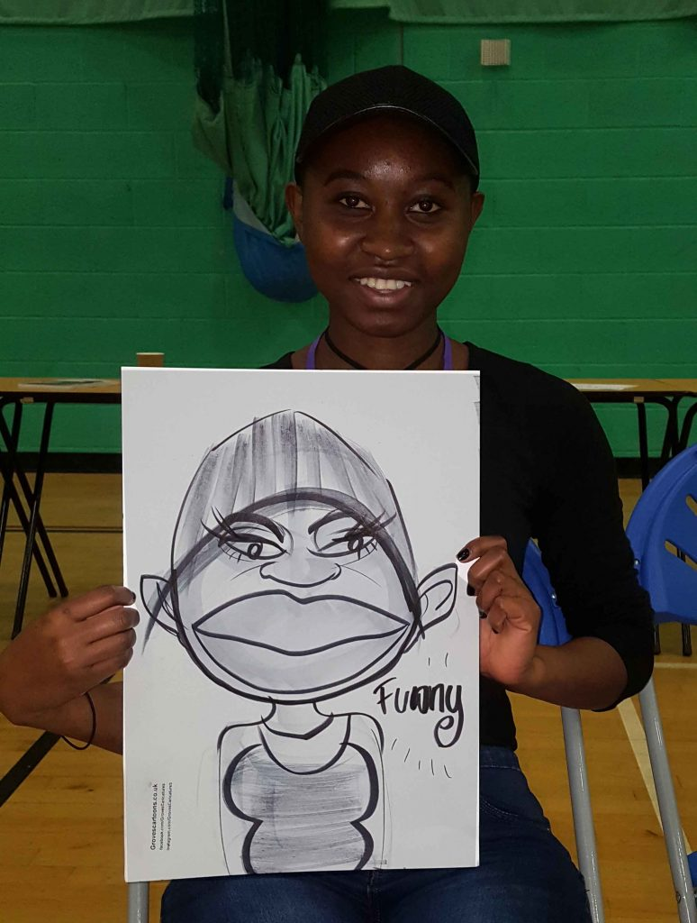 school prom entertainment involves a caricature artist drawing everyone like Funny with a great big smile