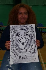 college caricature artist makes Nadia chuckle