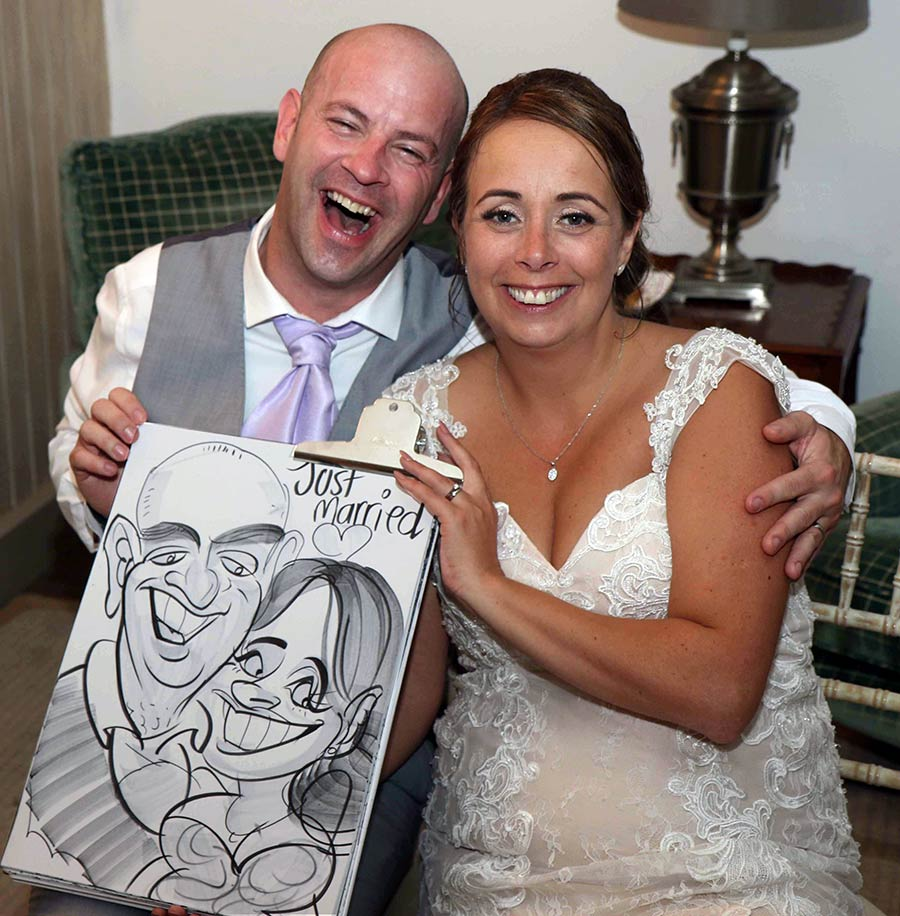 groom and bride laughing at their caricature