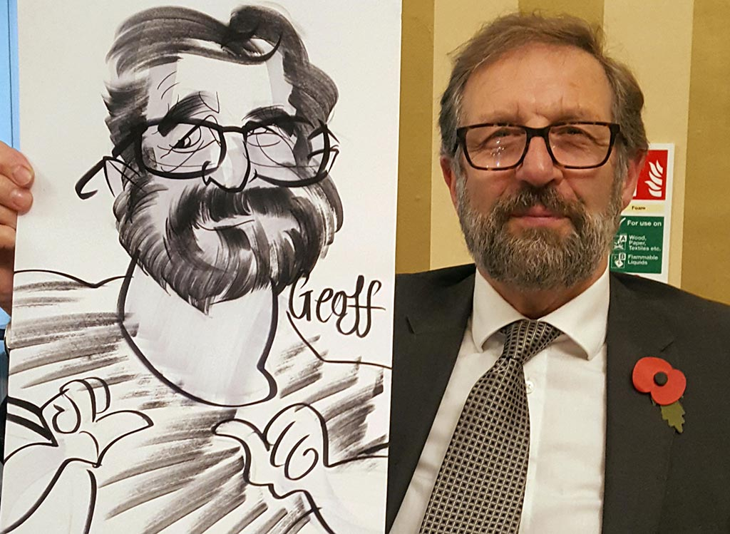 charity dinner caricaturist draws Geoff showing off