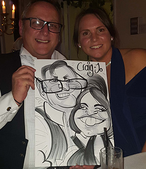 craig and jo getting a caricature