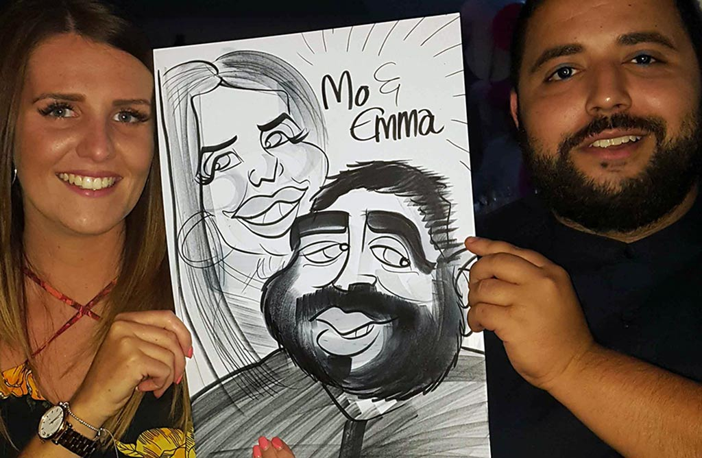 wedding caricaturist booked in Crawley Arora Hotel Mo and Emma are pleased with their cartoon