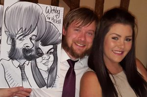award ceremony caricaturist Webby with a full Garibaldi beard to draw