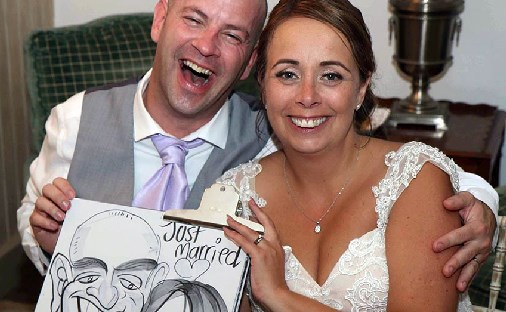 Bride and Groom enjoy sitting down for a caricature