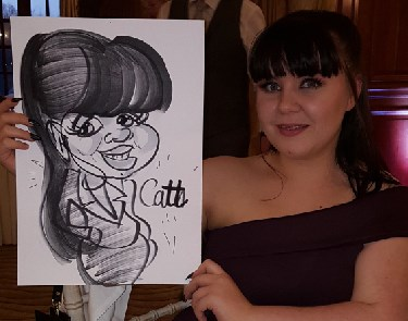 Cath poses with her caricature