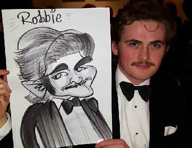 Robbie is caricatured with a tash