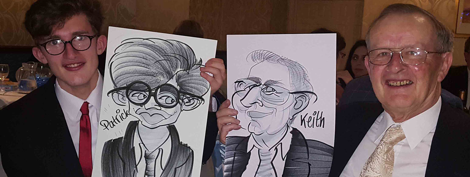 Patrick and Keith posture with their caricatures