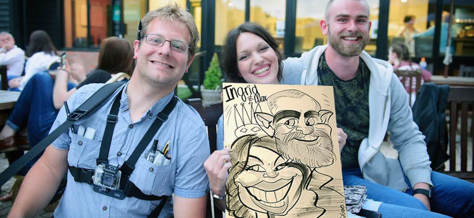 the caricature artist is asked to be in the photo