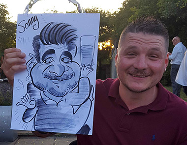 sonny the teacher posing with caricature