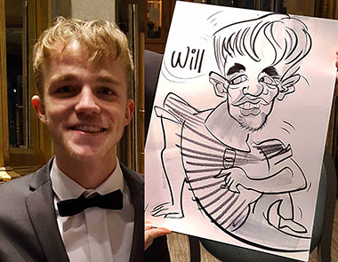 Will shows off his caricature at the school prom