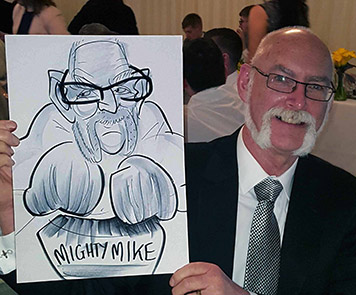 Mighty Mike showing the camera his caricature