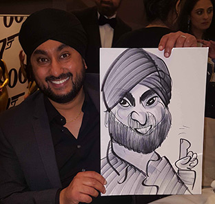 photo of a man holding his caricature at a film premier
