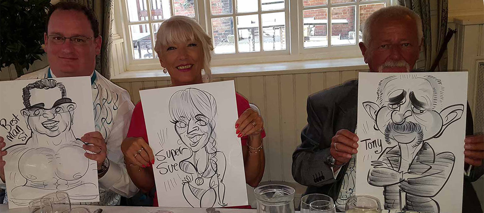 top table are showing the camera their caricatures