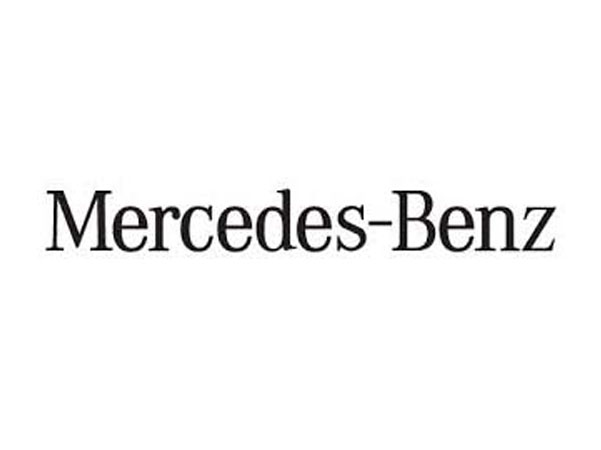 mercedes benz logo. Caricature artist draws in the show room