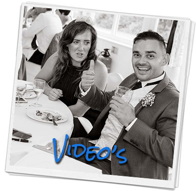 Wedding guest gives a thumbs up while seeing his caricature