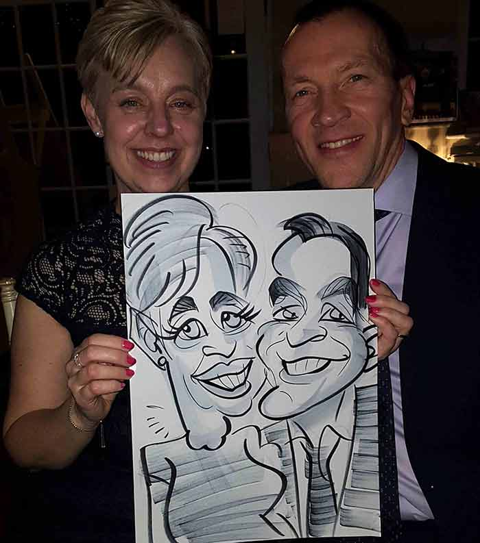couple pose for their cartoon style caricature