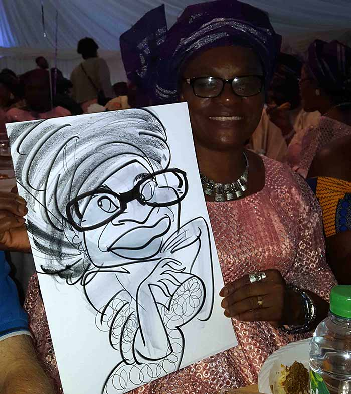 Wedding Caricaturist captures lady on paper