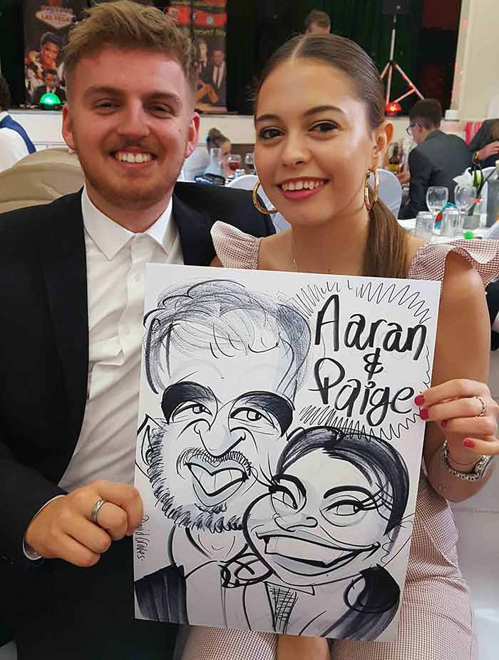 Aaran and Paige love their caricature