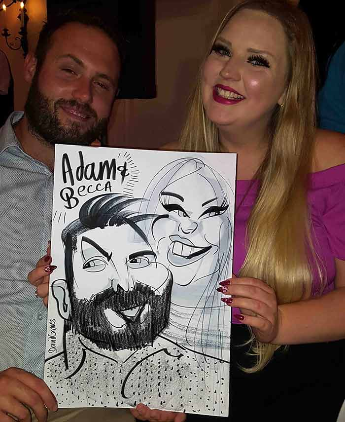 Adam promises Becca a caricature in Reading