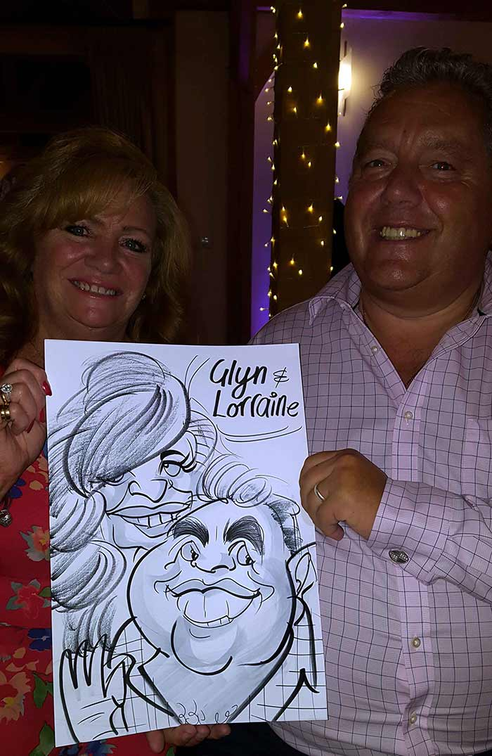 Glyn next to his wife poses with caricature