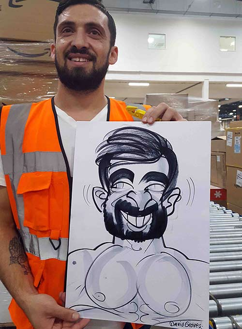 Amazon warehouse worker is surprised to see a caricaturist in a hard hat