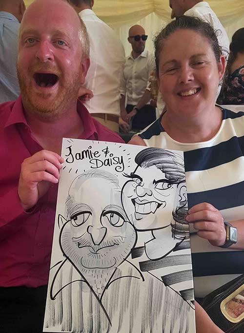 Sun burnt Jamie and Daisy handle their caricature