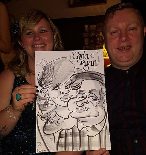Carla and Ryan show off their caricature