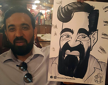 Man with thick black beard hold up caricature