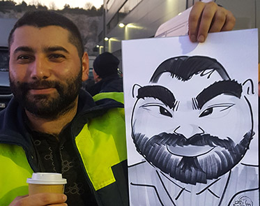 guests poses with his caricature at a Company party