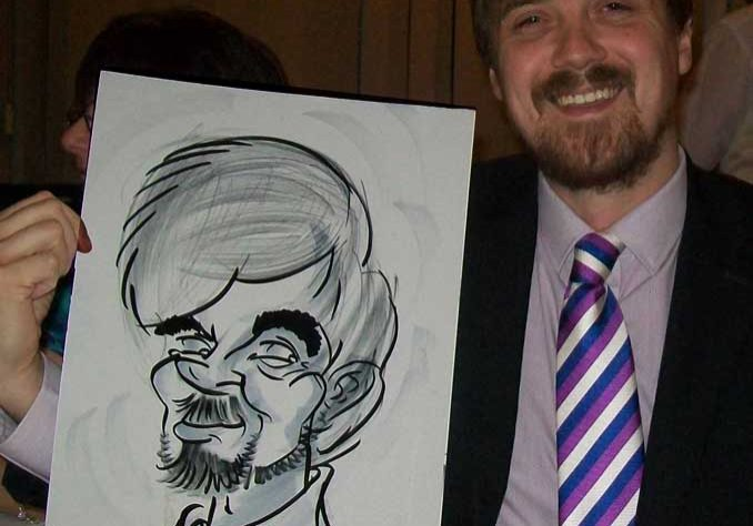 could be a wig but the beard is great as the man poses with his caricature in Portsmouth