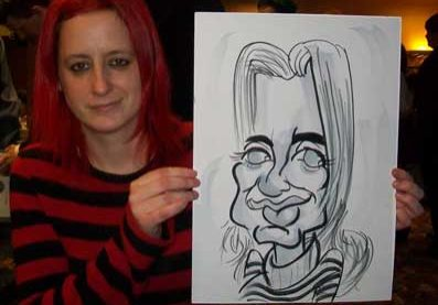 female comedian taking a break and being caricatured. she was very funny for this christmas works party